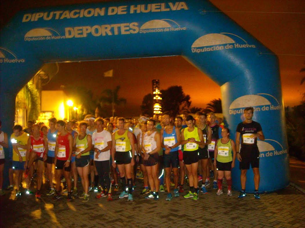 José Luis Ferrer y Esther Fernández Ganan la II Carrera Nocturna Entorno de La Rábida
